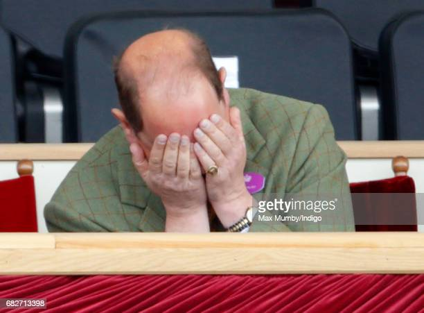 Prince Edward Earl of Wessex puts his head in his hands as he watches the Pony Club event on day 4 of the Royal Windsor Horse Show in Home Park on...