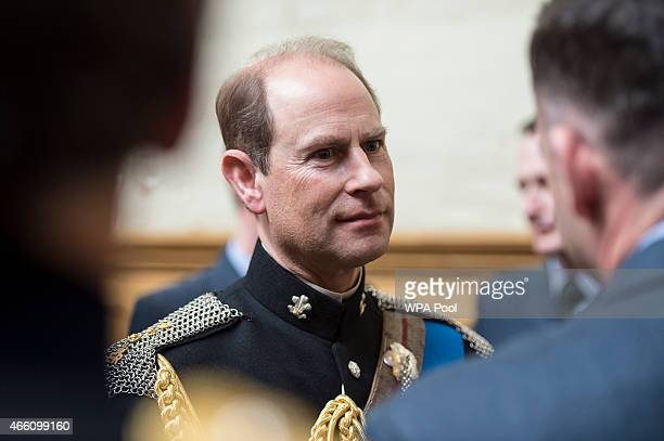 Prince Edward Earl of Wessex speaks with military personnel during a reception at the Honourable Artillery Company following the Afghanistan service...