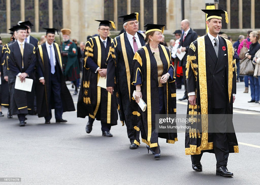 Prince Edward, Earl of Wessex (right) takes part in a procession after being installed as Chancellor of the University of Bath during a service at Bath Abbey on November 7, 2013 in Bath, England.
