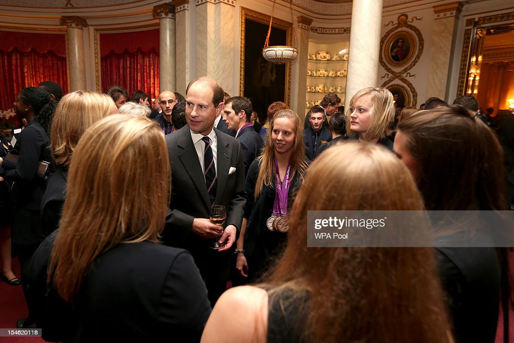 Prince Edward, Earl of Wessex talks to athletes during a reception for the Team GB Olympic and Paralympic medalists at Buckingham Palace on October 23, 2012 in London, England.