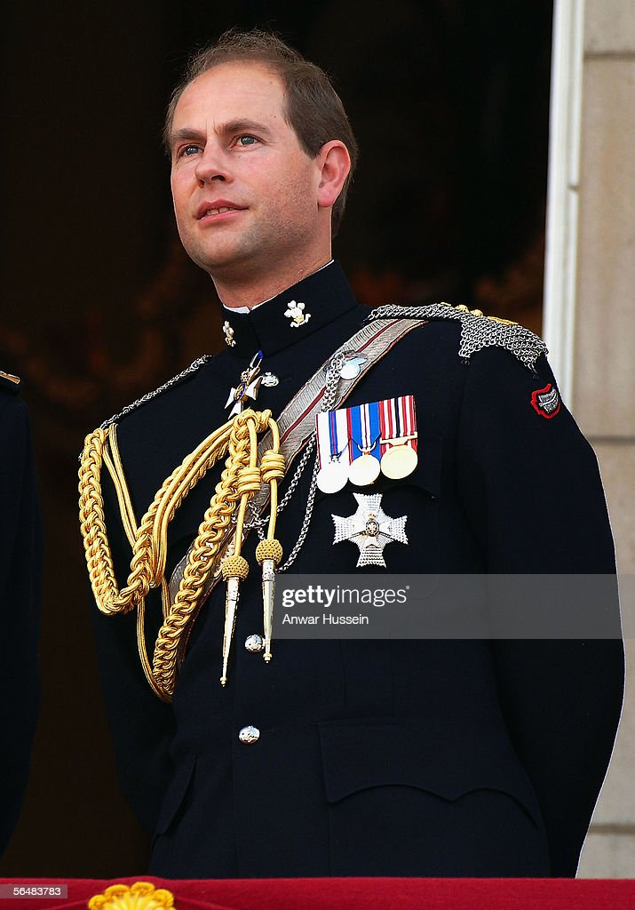 Prince Edward, Earl of Wessex watches the flypast over the Mall of British and US World War II aircraft from the balcony of Buckingham Palace on National Commemoration Day, July 10, 2005, in London, England.