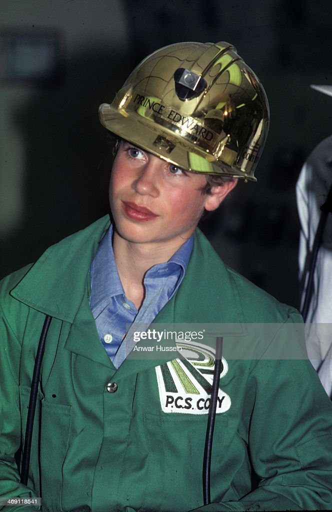 Prince Edward is provided with a protective gold helmet as he visits a P.C.S. Cory mine on July 01, 1976 in Canada.