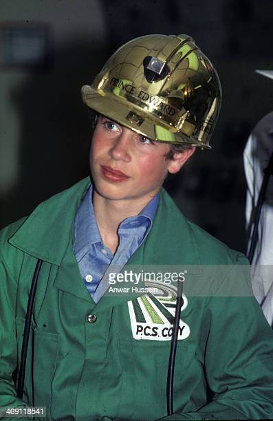 Prince Edward is provided with a protective gold helmet as he visits a PCS Cory mine on July 01 1976 in Canada