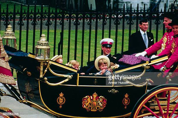 Prince Edward rides in an open carriage with pageboy Prince William following the wedding of Prince Andrew and Sarah Ferguson on July 23 1986 in...