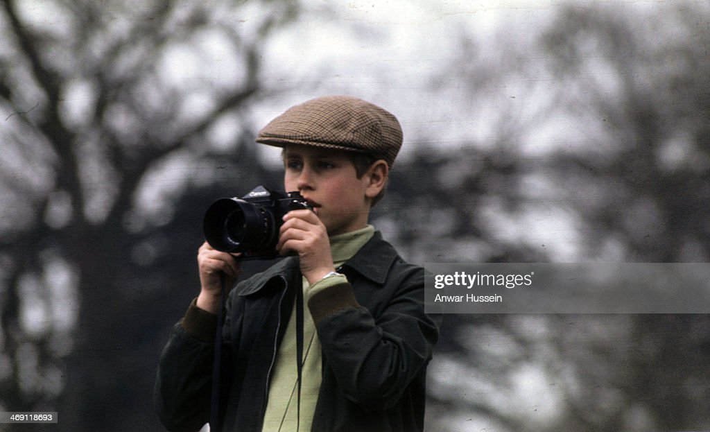 Prince Edward takes photographs with his camera during Badminton Horse Trials on April 10, 1976 in Badminton, England.