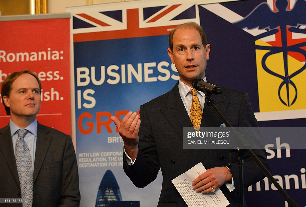 Prince Edward the Earl of Wessex delivers a speech next to British Ambassador to Romania Martin Harris (L) at the launch of the British Business Portal, a project to bring new British business to Romania in Bucharest on June 15, 2013. The British Business Portal is a networking platform, focusing on offering information on various sectors of the Romanian economy: business opportunities, events, requests for partnerships, how to do business and relevant legislation. AFP PHOTO DANIEL MIHAILESCU