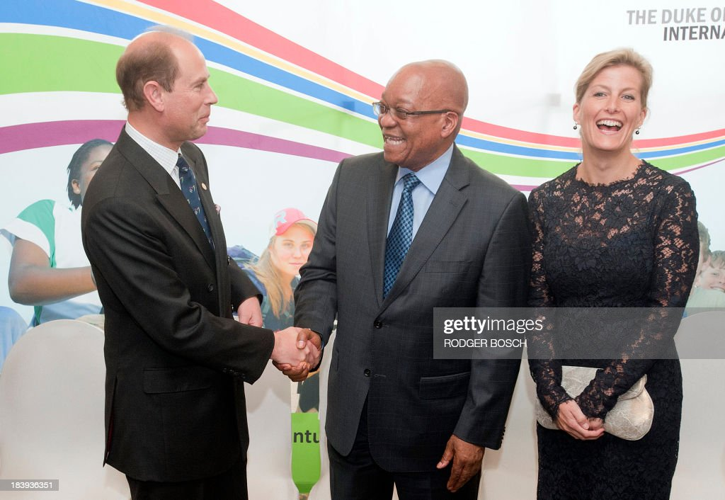 Prince Edward (L), the Earl of Wessex shares a joke with South African President Jacob Zuma (C) and his wife Sophie during the awards ceremony for the President's Award for Youth Empowerment on 10 October 2013, at a hotel in Cape Town. The awards are given to young people who have excelled in various fields in conjunction with the Duke of Edinburgh's International Award Foundation. BOSCH