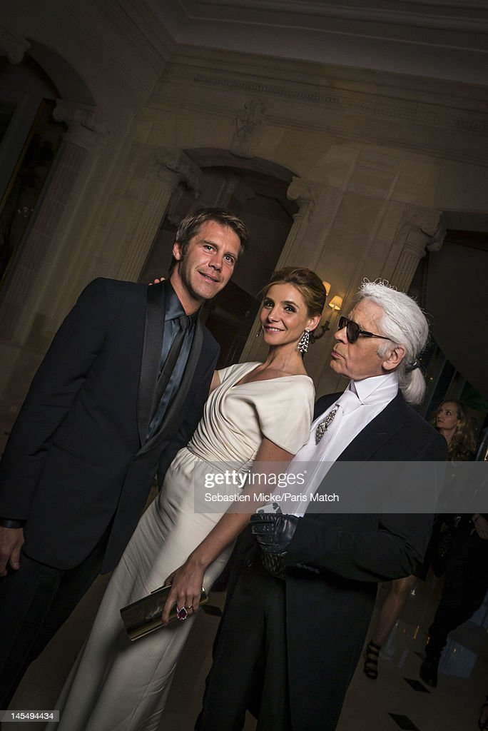 Prince Emmanuel Philibert of Savoy with wife, French actress Clotilde Courau, and Karl Lagerfeld, are photographed at the amfAR Cinema Against AIDS gala, for Paris Match on May 24, 2012, in Cap d'Antibes, France.