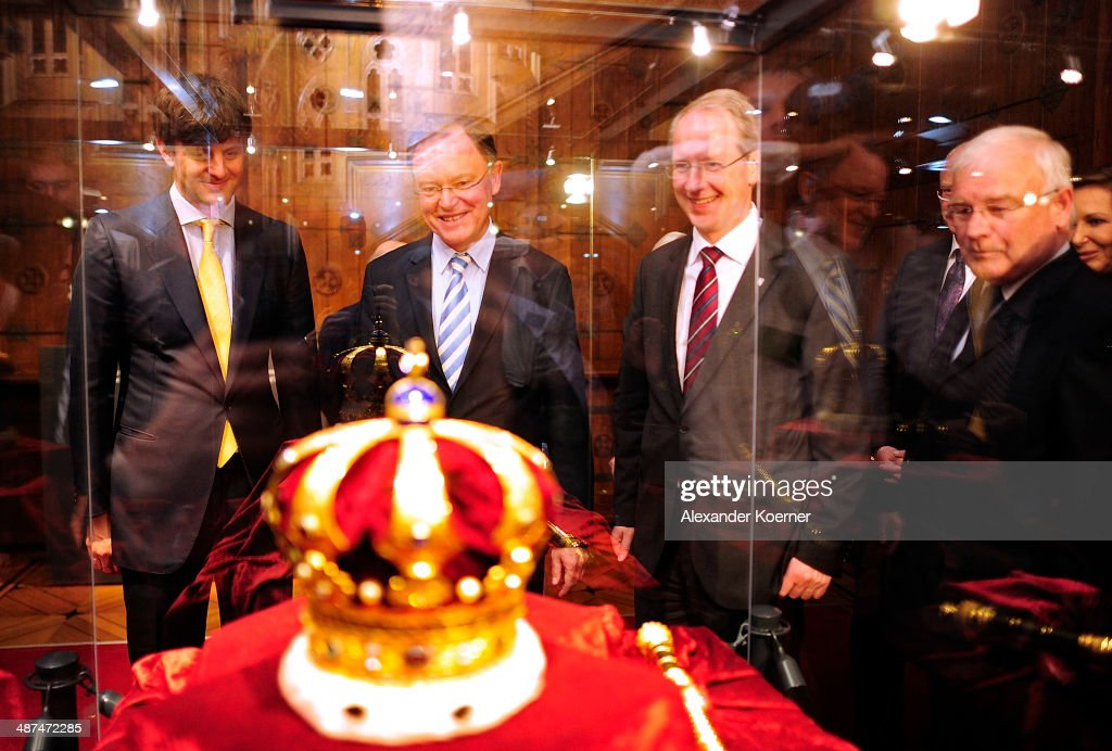 Prince Ernst August of Hanover, Prime Minister of the State of Lower Saxony Stephan Weil and mayor of Hanover Stefan Schostock stand in front of the Royal Crown of Hanover during the official opening of the 'Der Weg zur Krone - Das Koenigreich Hannover und seine Herrscher' ('The Road to the Crown - The Kingdom of Hanover and Its Rulers) exhibition at Schloss Marienburg at Schloss Marienburg on April 30, 2014 in Pattensen, Germany. The city of Hanover is scheduled to hold a celebration for the British Royal Family to mark the '300-year personal union' in May and June this year. Prince Andrew, Duke of York, is expected to take part in the celebrations in June.