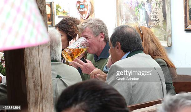 Prince Ernst August von Hannover and guest attend the Oktoberfest Opening in Kaeferzelt at Theresienwiese on September 20 2014 in Munich Germany