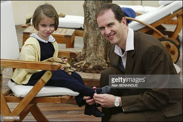 Prince Eudes of Orleans with daughter HRH princess Therese of Orleans On a terrace at Martinez Hotel Cannes in Cannes France on March 19 2004