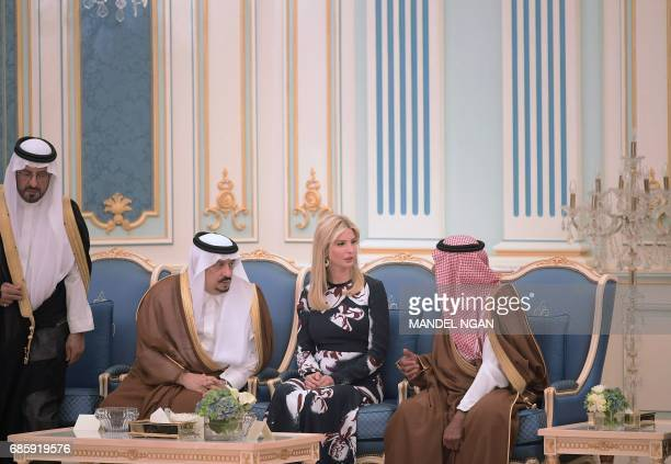 Prince Faisal bin Bandar the governor of the Saudi capital Riyadh listens on as Ivanka Trump talks to an unidentified Saudi official during a...