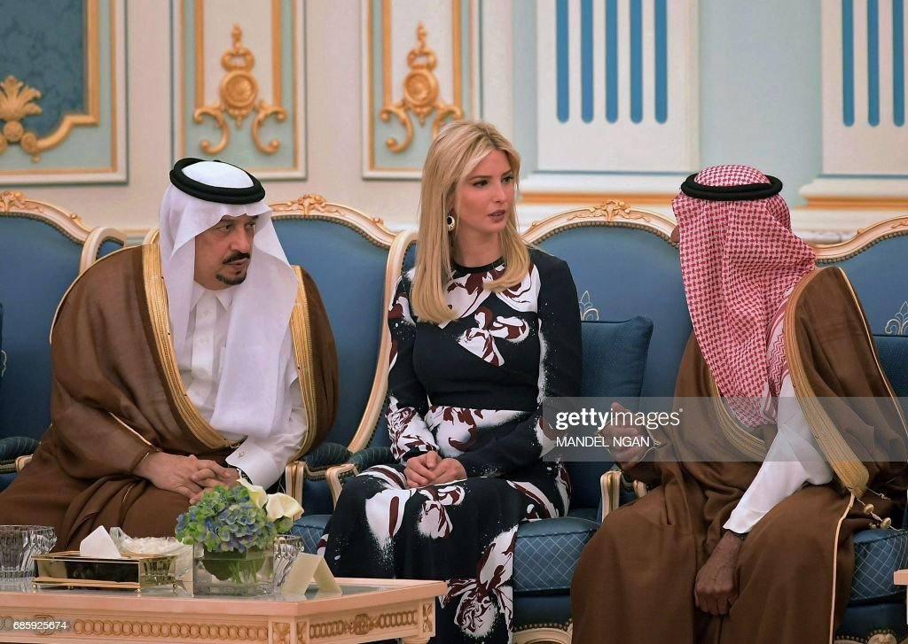 Prince Faisal bin Bandar (L), the governor of the Saudi capital Riyadh, listens on as Ivanka Trump talks to an unidentified Saudi official during a ceremony where her father US President Donald Trump received the Order of Abdulaziz al-Saud medal from Saudi Arabia's King Salman bin Abdulaziz al-Saud at the Royal Court in Riyadh on May 20, 2017. /