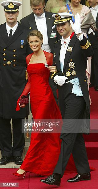 Prince Felipe and fiancee Letizia Ortiz Rocasolano leave Copenhagen Cathedral after the wedding ceremony between Danish Crown Prince Frederik and his...