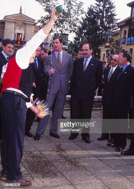 Prince Felipe de Borbon during his visit to Asturias try pouring the 'sidra' wine typical of this land Oviedo Spain