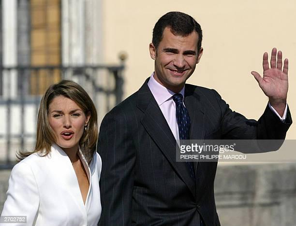 Prince Felipe of Spain and his fiancee Spanish journalist Letizia Ortiz Rocasolano wave at the Pardo Palace near Madrid 06 November 2003 Prince...