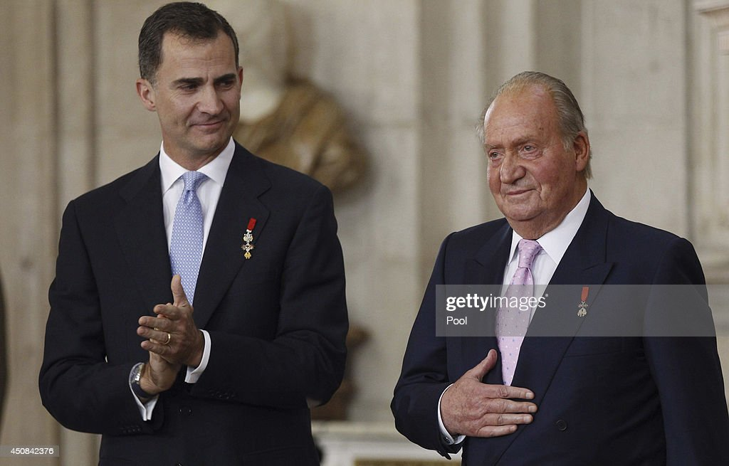 Prince Felipe of Spain and King Juan Carlos of Spain attend the official abdication ceremony at the Royal Palace on June 18 2014 in Madrid Spain King...