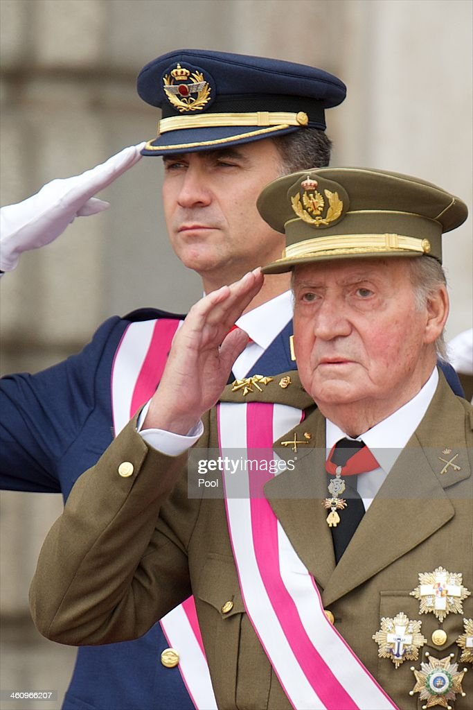 Prince Felipe of Spain (L) and King Juan Carlos of Spain (R) attend the New Year's Military Parade at the Royal Palace on January 6, 2014 in Madrid, Spain.