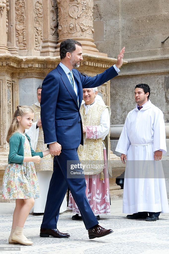 Prince Felipe of Spain and Princess <a gi-track='captionPersonalityLinkClicked' href=/galleries/search?phrase=Leonor+-+Princess+of+Asturias&family=editorial&specificpeople=6328965 ng-click='$event.stopPropagation()'>Leonor</a> of Spain attend Easter Mass at the Cathedral of Palma de Mallorca on March 31, 2013 in Palma de Mallorca, Spain.
