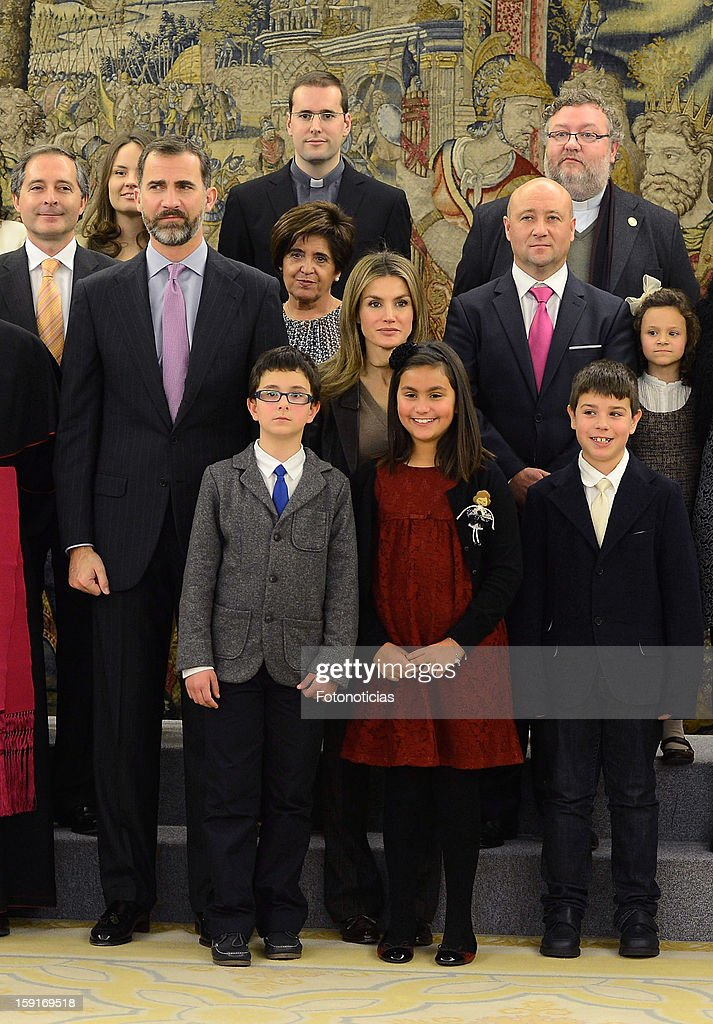 Prince Felipe of Spain (L) and Princess <a gi-track='captionPersonalityLinkClicked' href=/galleries/search?phrase=Letizia+of+Spain&family=editorial&specificpeople=158373 ng-click='$event.stopPropagation()'>Letizia of Spain</a> (C) attend an audience at Zarzuela Palace on January 9, 2013 in Madrid, Spain.