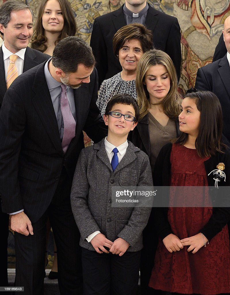 Prince Felipe of Spain (L) and Princess <a gi-track='captionPersonalityLinkClicked' href=/galleries/search?phrase=Letizia+of+Spain&family=editorial&specificpeople=158373 ng-click='$event.stopPropagation()'>Letizia of Spain</a> (2nd R) attend an audience at Zarzuela Palace on January 9, 2013 in Madrid, Spain.