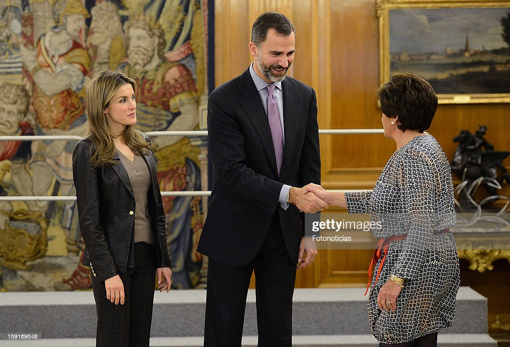 Prince Felipe of Spain (C) and Princess <a gi-track='captionPersonalityLinkClicked' href=/galleries/search?phrase=Letizia+of+Spain&family=editorial&specificpeople=158373 ng-click='$event.stopPropagation()'>Letizia of Spain</a> (L) attend an audience at Zarzuela Palace on January 9, 2013 in Madrid, Spain.