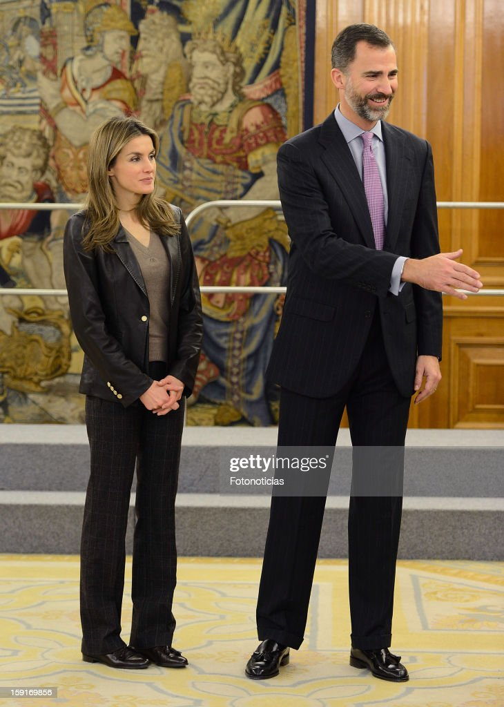 Prince Felipe of Spain (R) and Princess Letizia of Spain attend an audience at Zarzuela Palace on January 9, 2013 in Madrid, Spain.