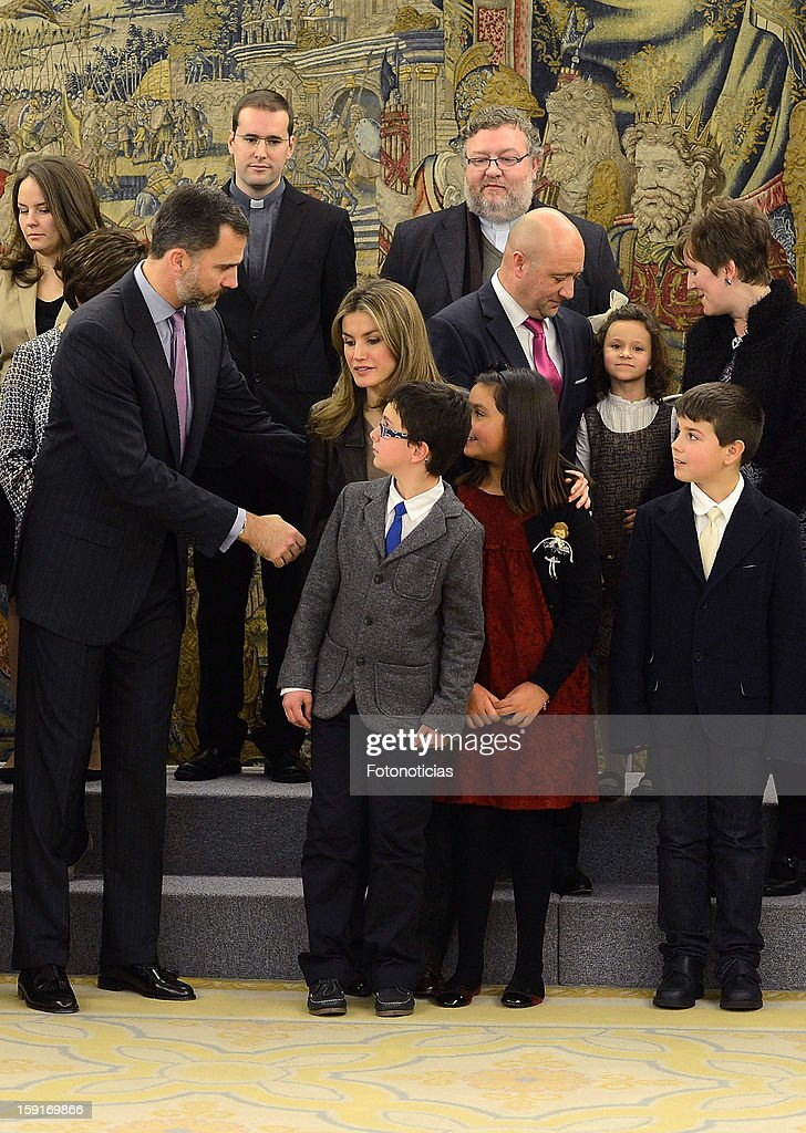 Prince Felipe of Spain (L) and Princess Letizia of Spain (2nd L) attend an audience at Zarzuela Palace on January 9, 2013 in Madrid, Spain.