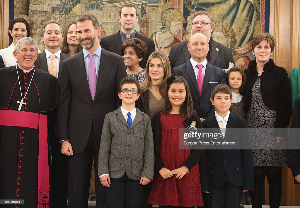 Prince Felipe of Spain (front 2nd L) and Princess <a gi-track='captionPersonalityLinkClicked' href=/galleries/search?phrase=Letizia+of+Spain&family=editorial&specificpeople=158373 ng-click='$event.stopPropagation()'>Letizia of Spain</a> (C) attend audiences at Zarzuela Palace on January 9, 2013 in Madrid, Spain.