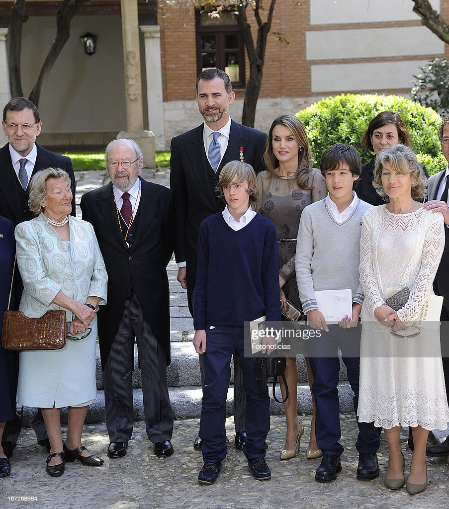 Prince Felipe of Spain and Princess <a gi-track='captionPersonalityLinkClicked' href=/galleries/search?phrase=Letizia+of+Spain&family=editorial&specificpeople=158373 ng-click='$event.stopPropagation()'>Letizia of Spain</a> pose for a group picture with Cervantes Award winner Jose Manuel Caballero Bonald and his family after the Cervantes Awards Ceremony at Alcala de Henares University on April 23, 2013 in Alcala de Henares, Spain.