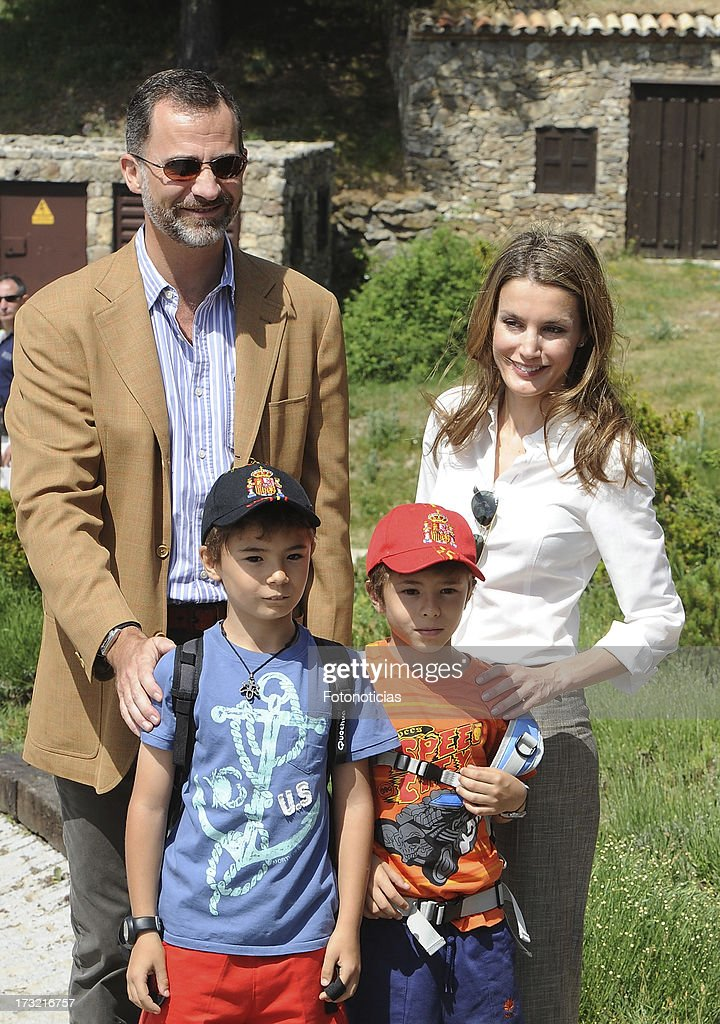 Prince Felipe of Spain (L) and Princess <a gi-track='captionPersonalityLinkClicked' href=/galleries/search?phrase=Letizia+of+Spain&family=editorial&specificpeople=158373 ng-click='$event.stopPropagation()'>Letizia of Spain</a> (R) pose with two children visitors during their visit to Sierra de Guadarrama National Park on July 10, 2013 in Rascafria, Spain.