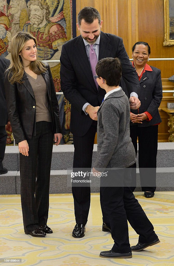 Prince Felipe of Spain (C) and Princess <a gi-track='captionPersonalityLinkClicked' href=/galleries/search?phrase=Letizia+of+Spain&family=editorial&specificpeople=158373 ng-click='$event.stopPropagation()'>Letizia of Spain</a> (L) receive a group of children, winners of a drawing contest, at Zarzuela Palace on January 9, 2013 in Madrid, Spain.