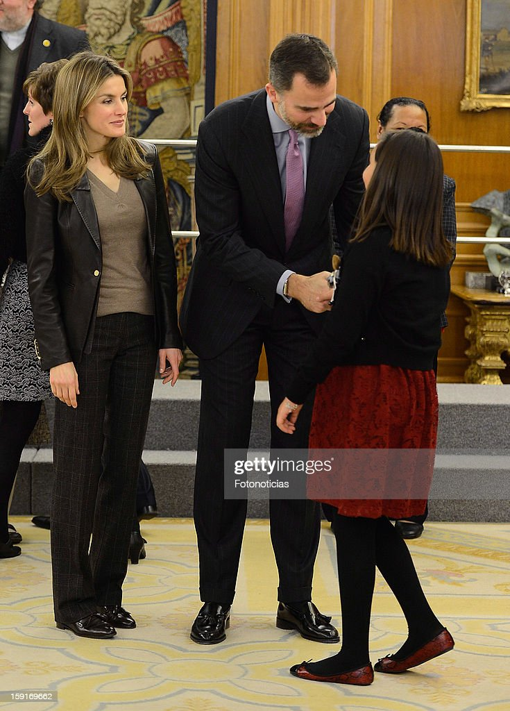 Prince Felipe of Spain (C) and Princess Letizia of Spain receive a group of children winners of a drawing contest at Zarzuela Palace on January 9, 2013 in Madrid, Spain.