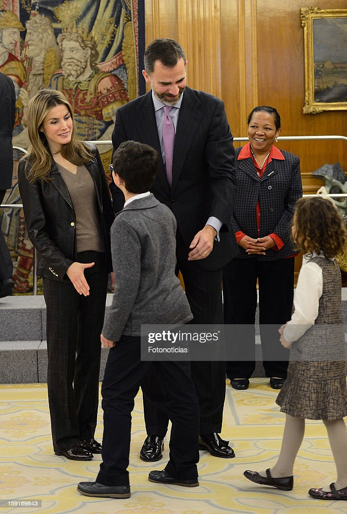 Prince Felipe of Spain (C) and Princess Letizia of Spain (L) receive a group of children, winners of a drawing contest, at Zarzuela Palace on January 9, 2013 in Madrid, Spain.