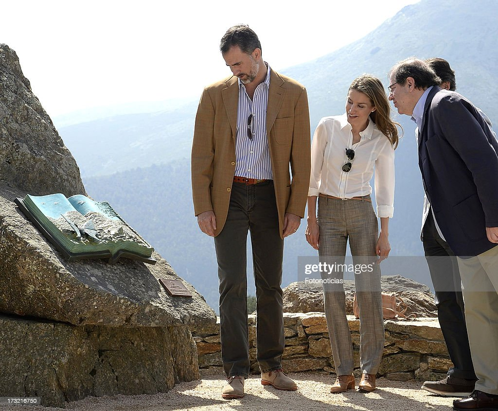 Prince Felipe of Spain (L) and Princess <a gi-track='captionPersonalityLinkClicked' href=/galleries/search?phrase=Letizia+of+Spain&family=editorial&specificpeople=158373 ng-click='$event.stopPropagation()'>Letizia of Spain</a> (C) visit Sierra de Guadarrama National Park on July 10, 2013 in Rascafria, Spain.