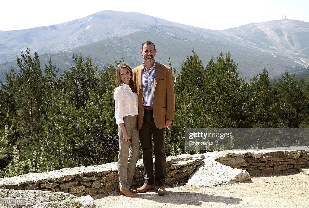 Prince Felipe of Spain (R) and Princess <a gi-track='captionPersonalityLinkClicked' href=/galleries/search?phrase=Letizia+of+Spain&family=editorial&specificpeople=158373 ng-click='$event.stopPropagation()'>Letizia of Spain</a> visit Sierra de Guadarrama National Park on July 10, 2013 in Rascafria, Spain.