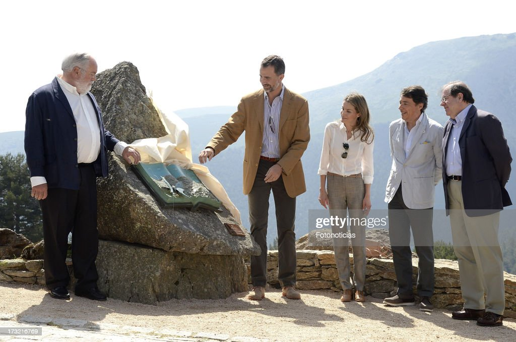 Prince Felipe of Spain (2nd L) and Princess <a gi-track='captionPersonalityLinkClicked' href=/galleries/search?phrase=Letizia+of+Spain&family=editorial&specificpeople=158373 ng-click='$event.stopPropagation()'>Letizia of Spain</a> (C) visit Sierra de Guadarrama National Park on July 10, 2013 in Rascafria, Spain.