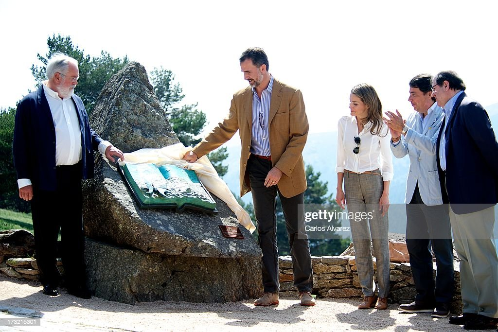 Prince Felipe of Spain (2L) and Princess <a gi-track='captionPersonalityLinkClicked' href=/galleries/search?phrase=Letizia+of+Spain&family=editorial&specificpeople=158373 ng-click='$event.stopPropagation()'>Letizia of Spain</a> (C) visit the new National Park of Sierra de Guadarrama on July 10, 2013 in Rascafria, near of Madrid, Spain.