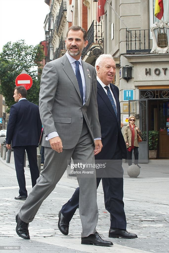 Prince Felipe of Spain (L) and Spanish Foreign Minister <a gi-track='captionPersonalityLinkClicked' href=/galleries/search?phrase=Jose+Manuel+Garcia+Margallo&family=editorial&specificpeople=8756020 ng-click='$event.stopPropagation()'>Jose Manuel Garcia Margallo</a> (R) attend the Red Cross Fundraising Day 2013 on October 3, 2013 in Madrid, Spain.
