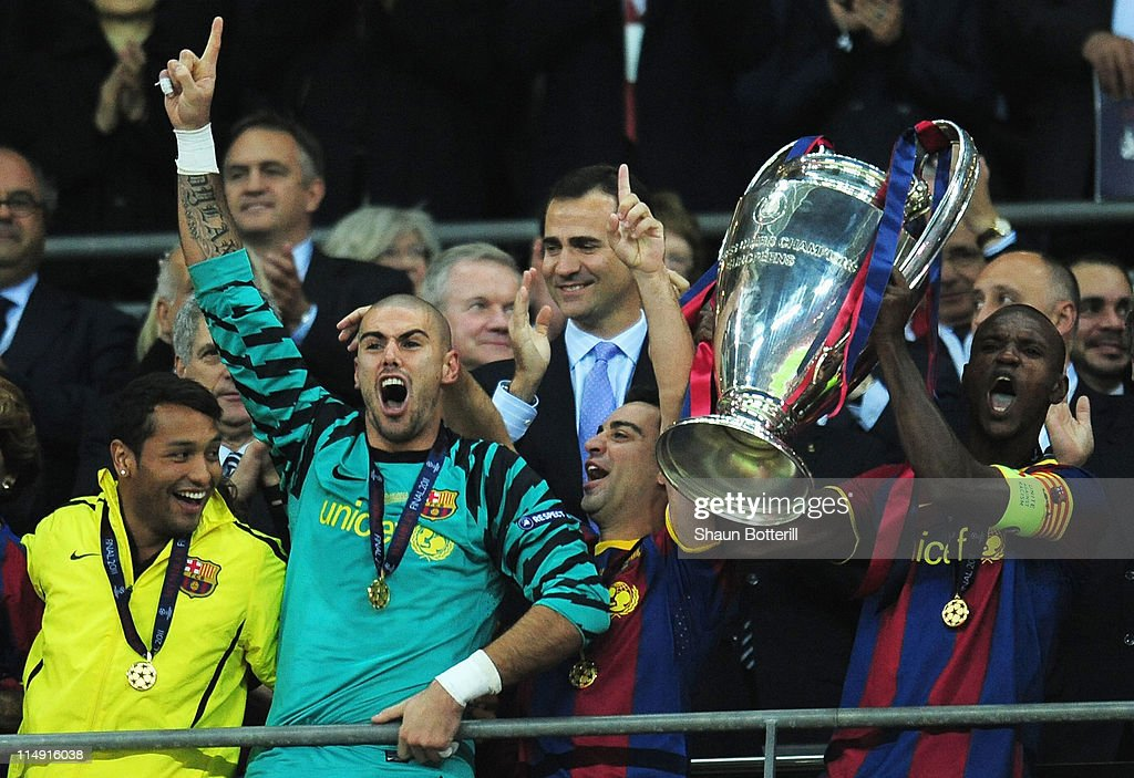Prince Felipe Of Spain applauds as Eric Abidal (R) of FC Barcelona lifts the trophy and celebrates with teammates after victory in the UEFA Champions League final between FC Barcelona and Manchester United FC at Wembley Stadium on May 28, 2011 in London, England.