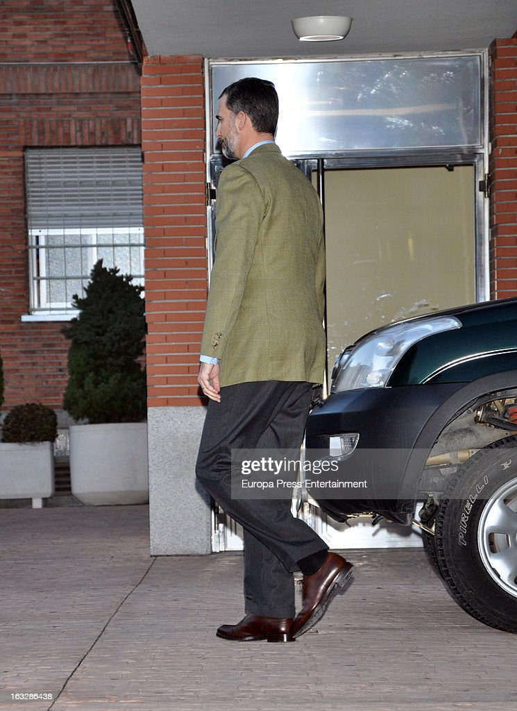 Prince Felipe of Spain comes back to his car to take a drawing made by his daughters Princess Leonor and Princess Sofia for King Juan Carlos of Spain at La Milagrosa Hospital on March 6, 2013 in Madrid, Spain. King Juan Carlos of Spain underwent surgery for a lower back disc hernia yesterday. He also had hip surgery last November. The King has had several other health issues in the past two years, including knee surgery and the removal of a benign lung tumor.