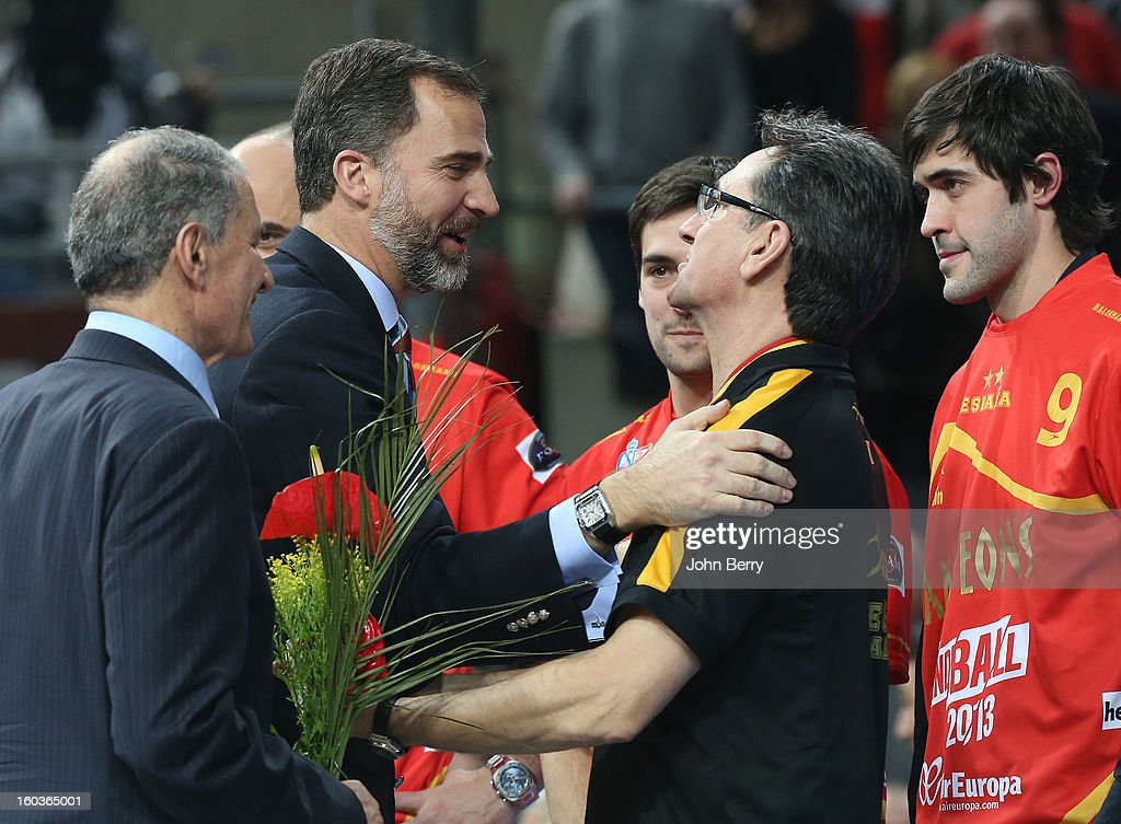 Prince Felipe of Spain handles the gold medal to Valero Rivera, coach of Spain, during the trophy ceremony after the Men's Handball World Championship 2013 final match between Spain and Denmark at Palau Sant Jordi on January 27, 2013 in Barcelona, Spain.