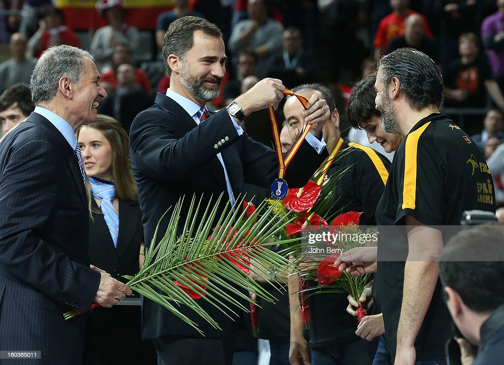 Prince Felipe of Spain handles the gold medals and the trophy to the spanish team during the trophy ceremony after the Men's Handball World Championship 2013 final match between Spain and Denmark at Palau Sant Jordi on January 27, 2013 in Barcelona, Spain.