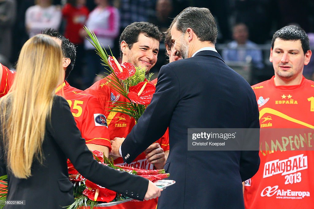 Prince Felipe of Spain (C) hands out a gold medal to <a gi-track='captionPersonalityLinkClicked' href=/galleries/search?phrase=Alberto+Entrerrios&family=editorial&specificpeople=727583 ng-click='$event.stopPropagation()'>Alberto Entrerrios</a> of Spain (L) on the podium after winningthe Men's Handball World Championship 2013 final match between Spain and Denmark at Palau Sant Jordi on January 27, 2013 in Barcelona, Spain.