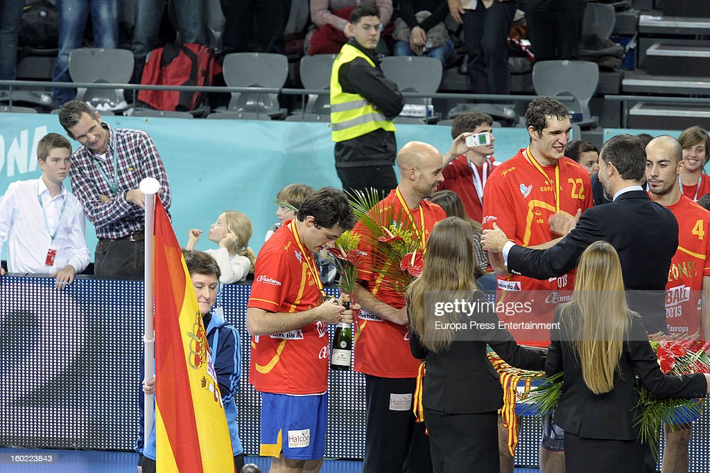 Prince Felipe of Spain (2R), his brother-in-law Inaki Urdangarin (2L) and his nephews Juan Valentin Urdangarin (L), Irene Urdangarin (3L) and Miguel Urdangarín (4L) attend the Men's Handball World Championship 2013 final match between Spain and Denmark at Palau Sant Jordi on January 27, 2013 in Barcelona, Spain.