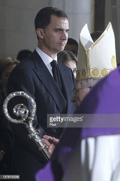 Prince Felipe of Spain looks across to Archbishop Antonio Maria Rouco Varela of Madrid during the funeral mass of Manuel Fraga Iribarne held in La...