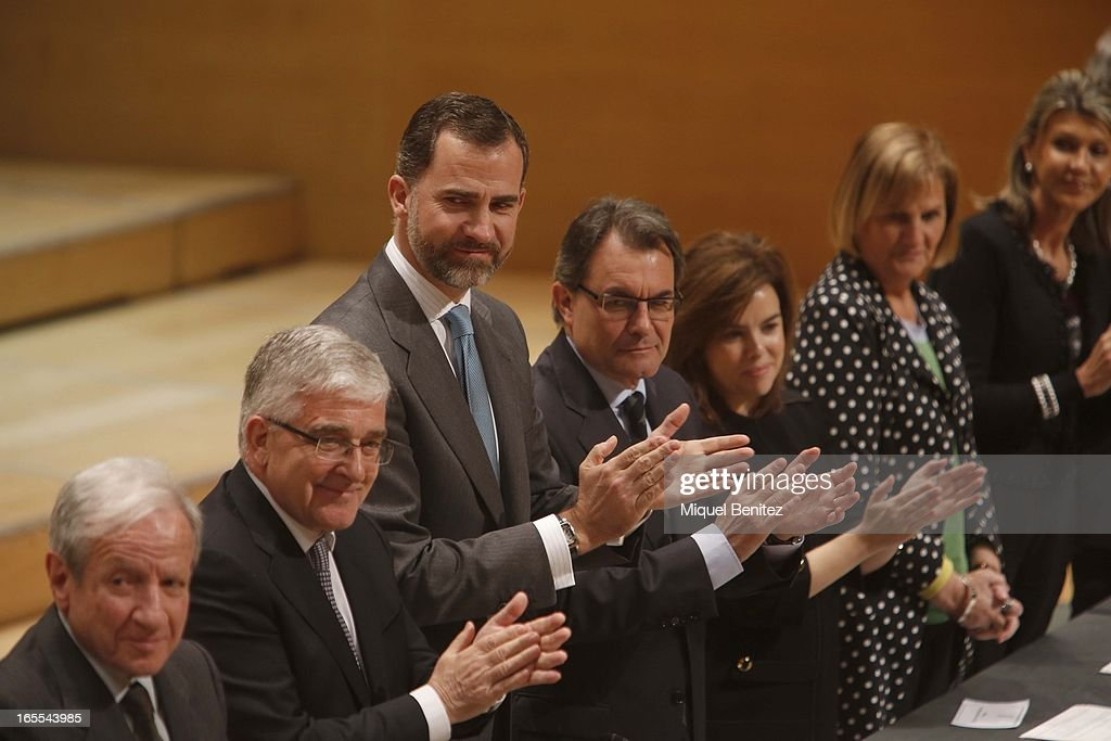 Prince Felipe of Spain, President of Catalonia <a gi-track='captionPersonalityLinkClicked' href=/galleries/search?phrase=Artur+Mas&family=editorial&specificpeople=712829 ng-click='$event.stopPropagation()'>Artur Mas</a> and <a gi-track='captionPersonalityLinkClicked' href=/galleries/search?phrase=Soraya+Saenz+de+Santamaria&family=editorial&specificpeople=5131705 ng-click='$event.stopPropagation()'>Soraya Saenz de Santamaria</a> attend a ceremony for recently graduated judges at the Auditori on April 4, 2013 in Barcelona, Spain.