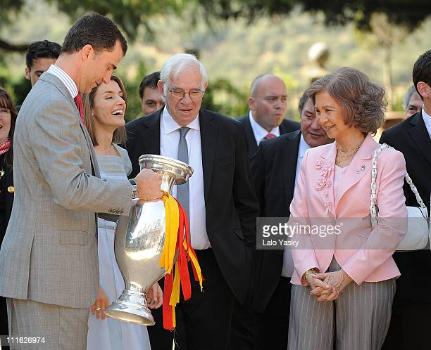 Prince Felipe of Spain Princess Letizia of Spain Spanish coach Luis Aragones and Queen Sofia of Spain stand with the Euro 2008 football trophy as the...