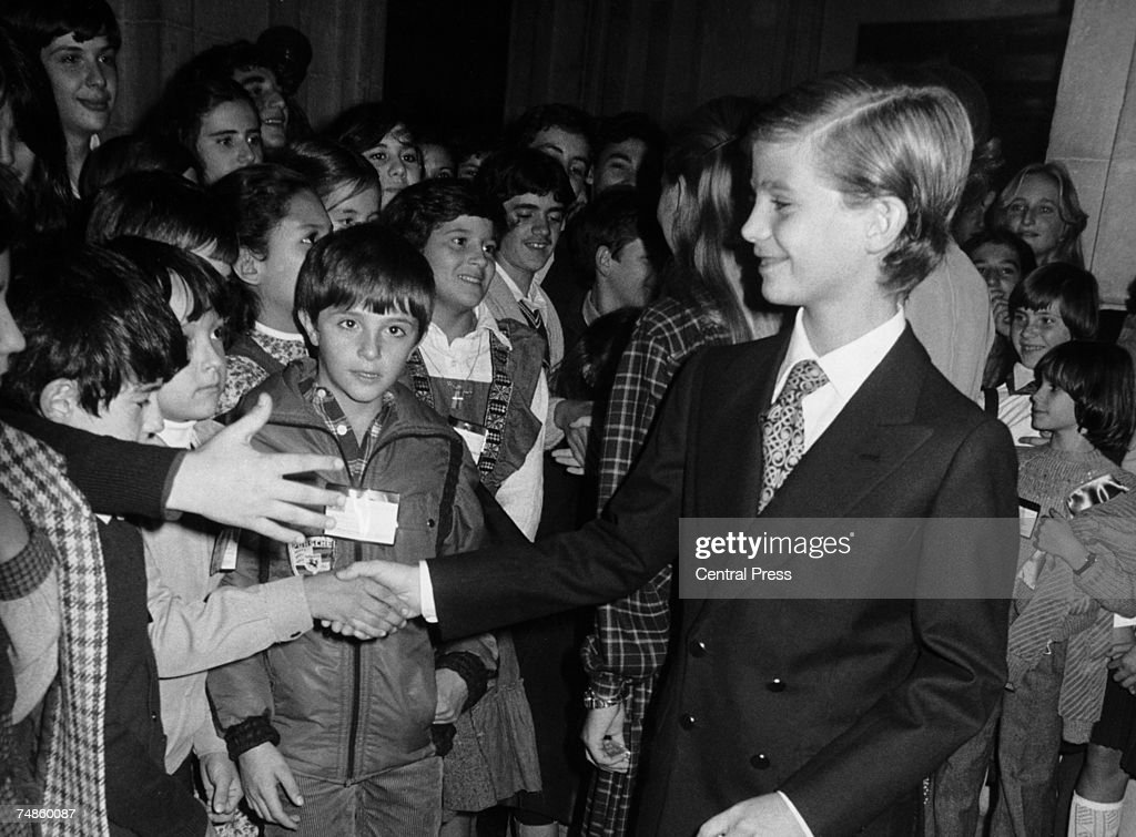 Prince Felipe of Spain shakes hands with children from 44 different countries, during the Children's International Congress in Madrid, 1st November 1979. The children have been invited to the royal palace by Felipe's father, King Juan Carlos.