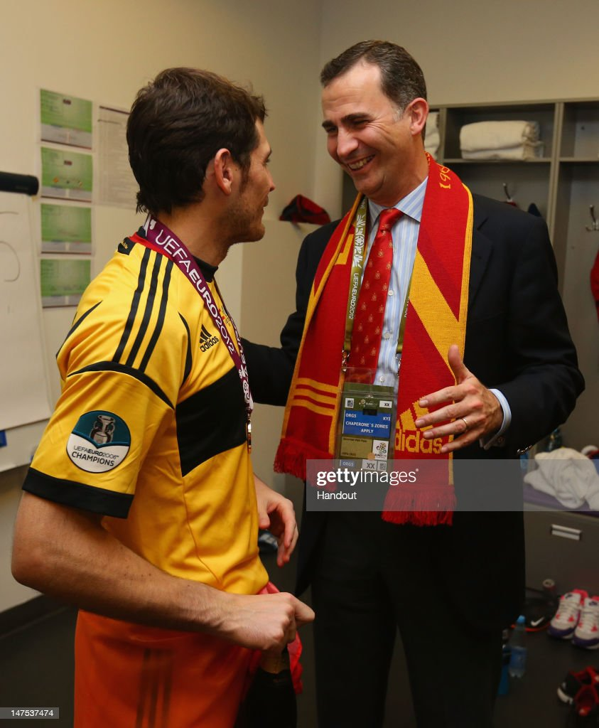 Prince Felipe of Spain speaks to Iker Casillas of Spain in the dressing room following the UEFA EURO 2012 final match between Spain and Italy at the Olympic Stadium on July 1, 2012 in Kiev, Ukraine.
